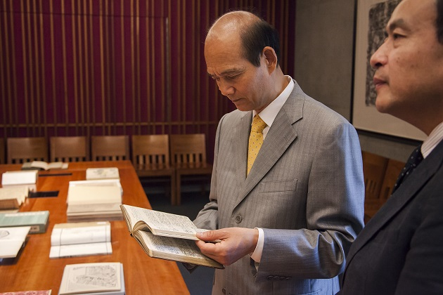 Chinese Consul General to San Francisco Luo Linquan studies a rare book.