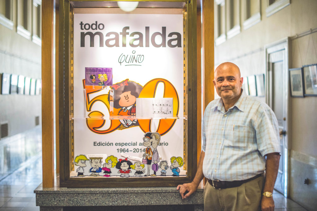 """Liladhar Pendse curated the Doe Library exhibit """"Beyond Tintin and Superman: The Diversity of Global Comics."""" (Photo by Alejandro Serrano for the University Library)"""