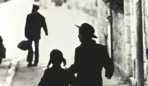 Man and girl on street