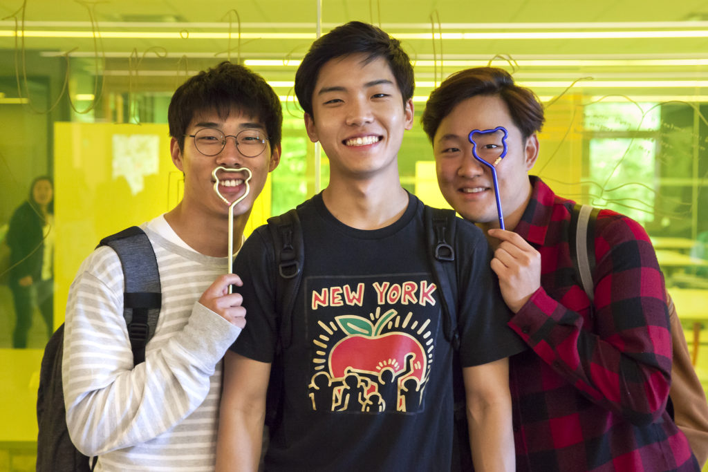 UC Berkeley students Youngwon Choi (left), Daniel Lim and Erin Choi enjoy Cal bear pencils at the open house. (Photo by Brittany Hosea-Small for the University Library)