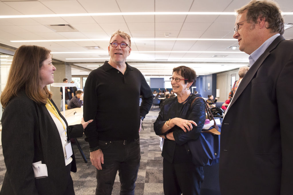 Associate University Librarian Beth Dupuis, University Librarian Jeff MacKie-Mason, Vice Chancellor for Undergraduate Education Cathy Koshland and Professor Bob Jacobsen enjoy the new Moffitt space. (Photo by Brittany Hosea-Small for the University Library)
