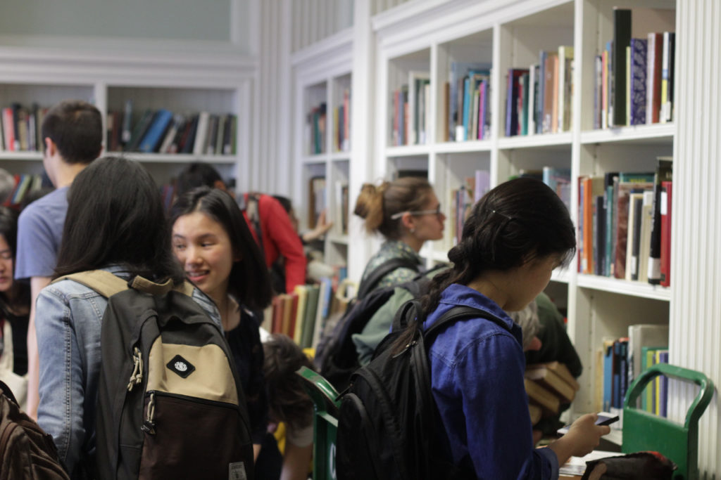 Patrons buy books at book sale