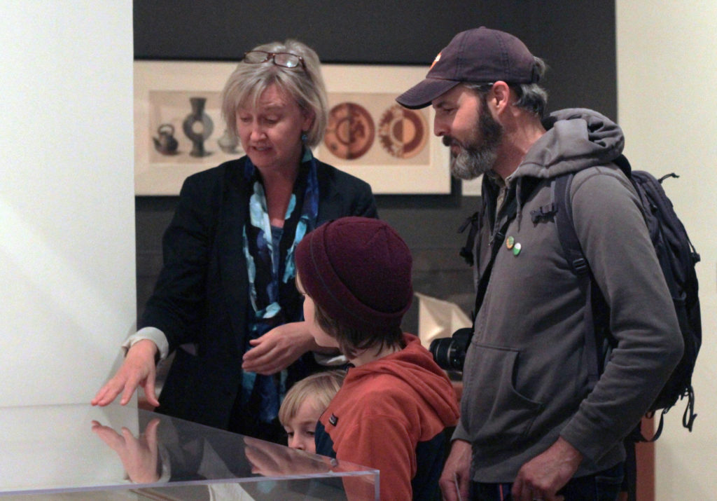 Curator discusses materials with patrons