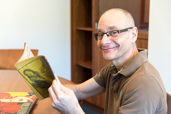Paul Fonoroff pictured in the C. V. Starr East Asian Library. (Photograph by Rachael Samberg for the University Library)