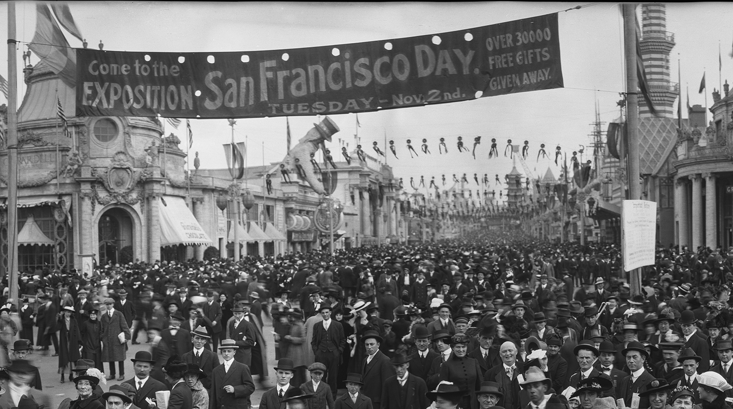 Detail of crowd under the San Francisco Day banner at the entrance to The Zone.
