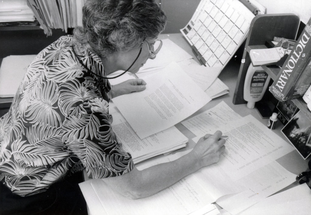 Photo of Malca Chall at her desk, mid-1980s