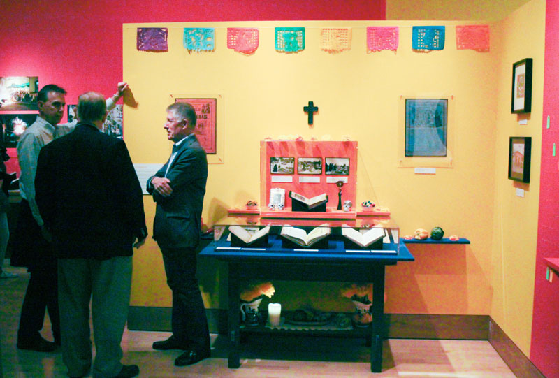 "Left to right: Kenny Grove, Peter Hanff, and Bo Wreden chat at the opening of the ""Viva La Fiesta"" exhibit in Bancroft Library on Oct. 12, 2017. (Photo by Jami Smith for the University Library)"