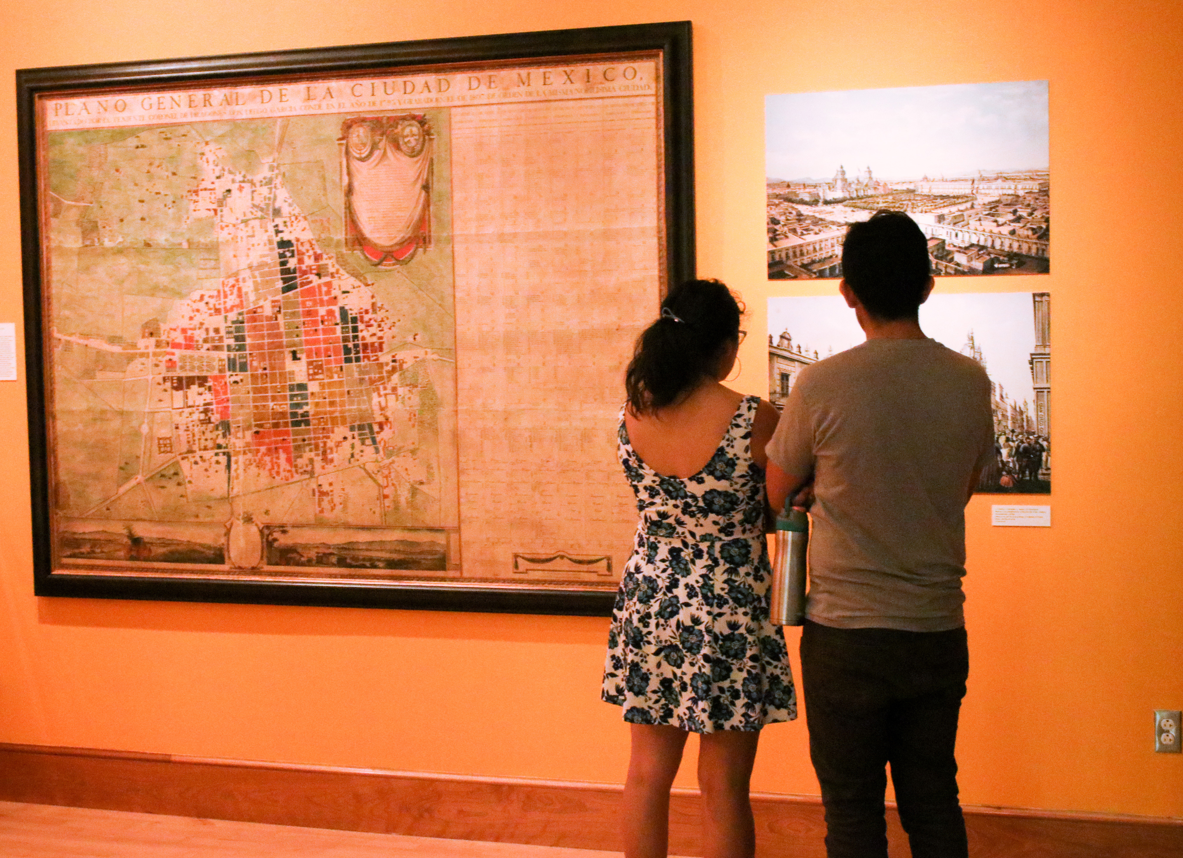 Visitors near a map