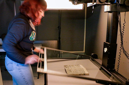 Employee demonstrates digitizing a Japanese travelogue from the 1800s