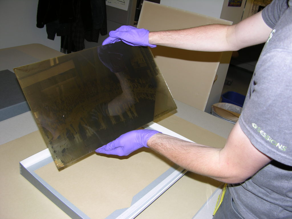 Handling large glass negative