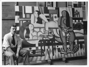 Fernand Leger with his painting Three Women.