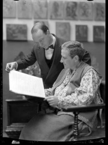 Gertrude Stein and Virgil Thomson looking at a musical score.