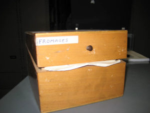Wooden box containing some of Bonney's notecards on cheese.