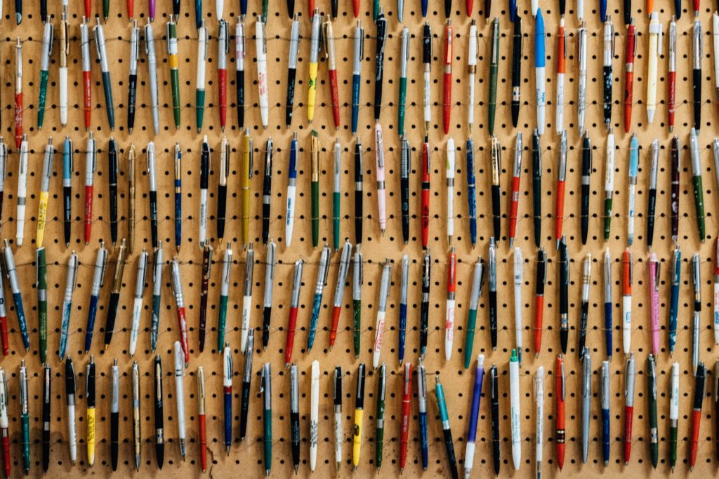 Photo of pens hanging on a pegboard