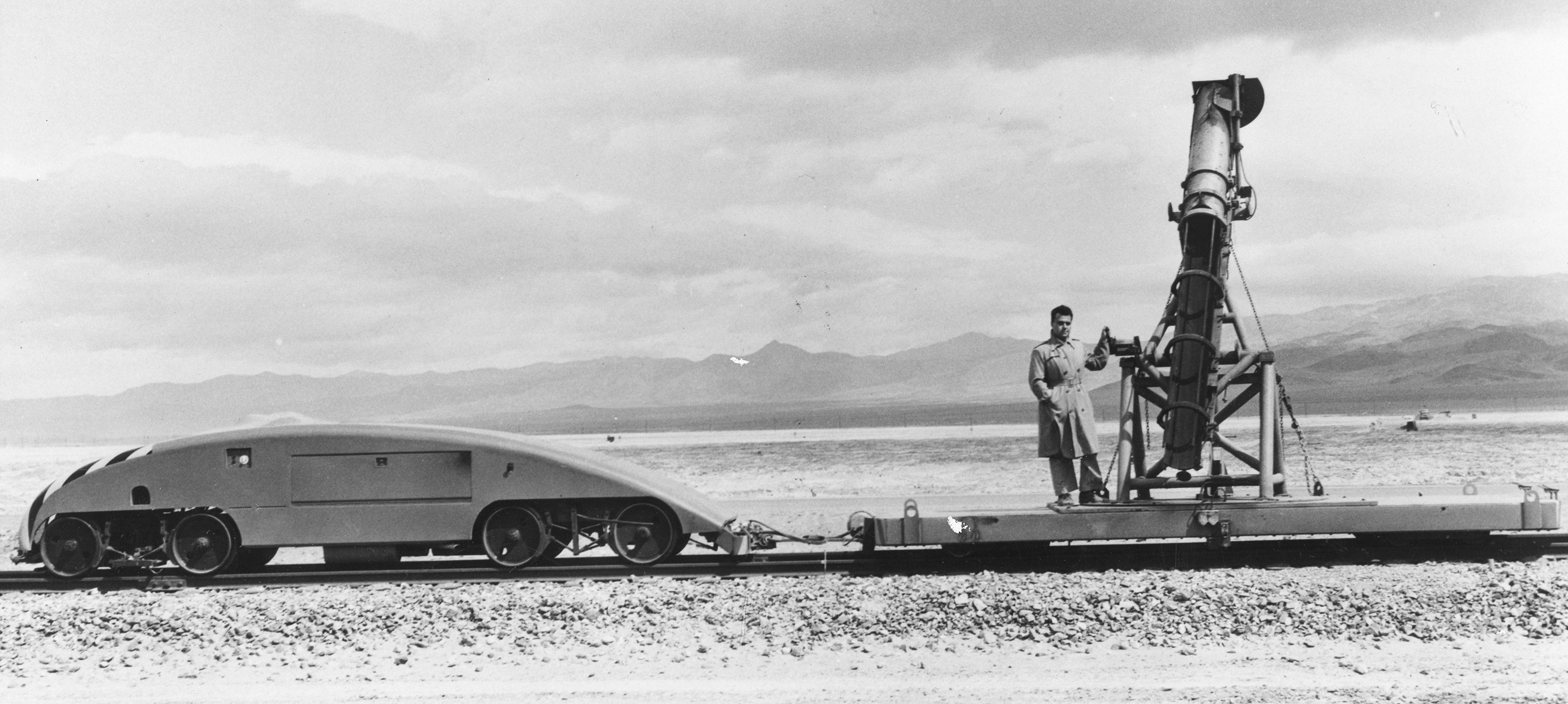 George Leitmann on rocket test track, China Lake, mid-1950s