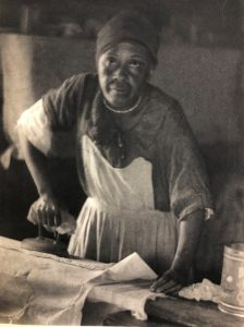 Artistic photo by Doris Ullmann of an African American woman ironing.