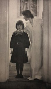 Artistic photograph of a daughter and mother, standing, circa 1903.