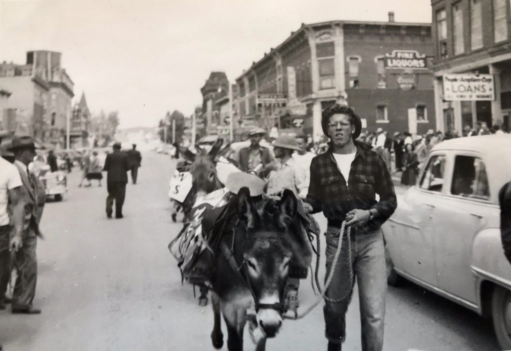 Bob Kendrick as a young man in parade for 23-mile Burro Race over Mosquito Pass, 1951