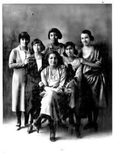 Six women posing for photo