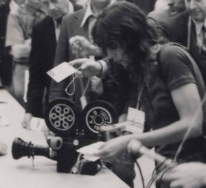 Nany Cain operating a camera