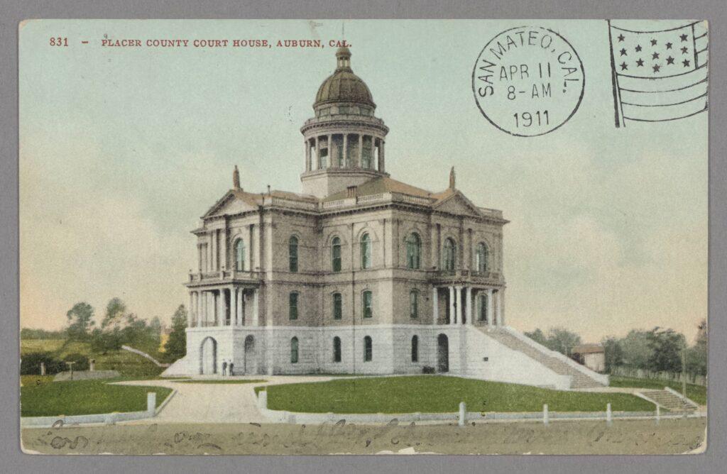 Color postcard, circa 1900-1910, of courhouse building exterior