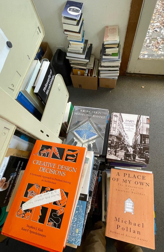Piles of books donated by Steward Brand