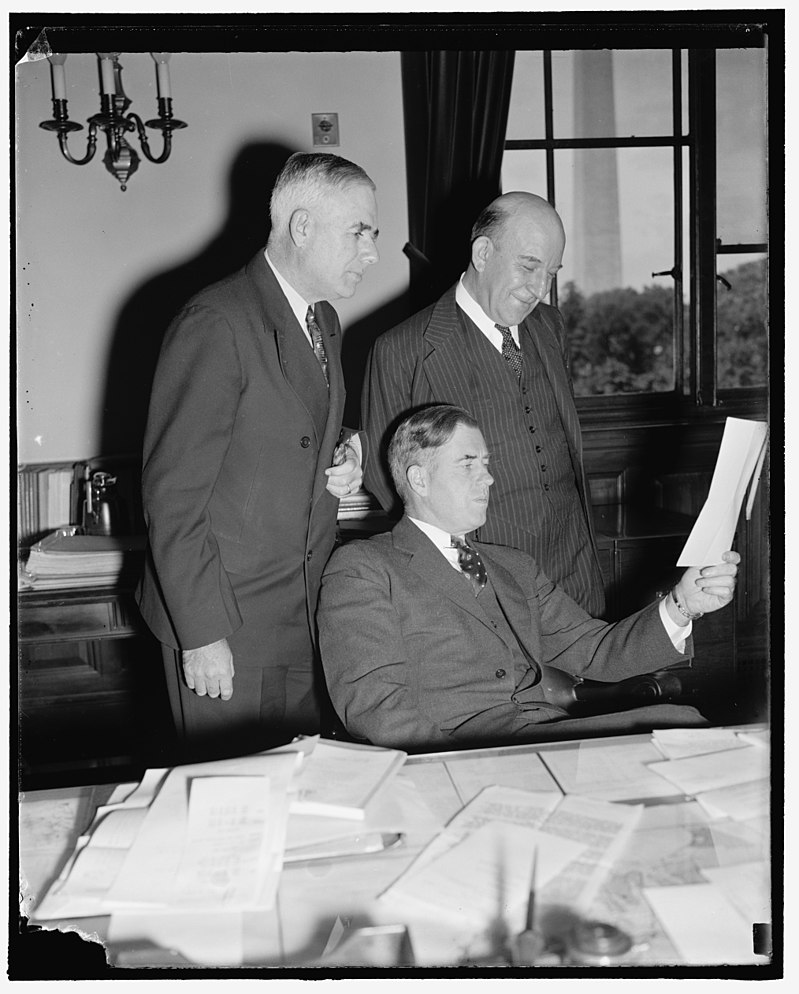 Shows the narrator in conversation with heads of the USDA, late 1930s