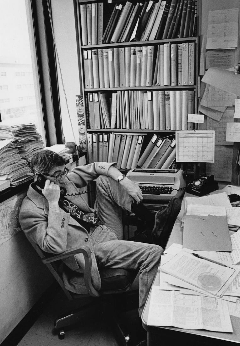 scientist sitting at desk, 1976
