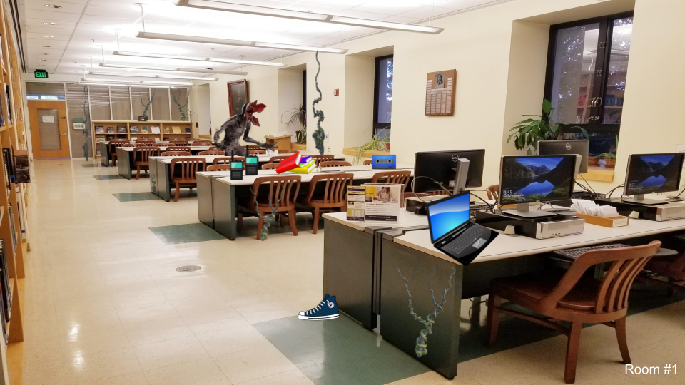 Library reading room with desks, chairs, computers, and books. On one table there is a laptop. On the floor there is one shoe. On another table there are two walkie talkies, books, and a cassette tape. In the back of the room is a demogorgon.
