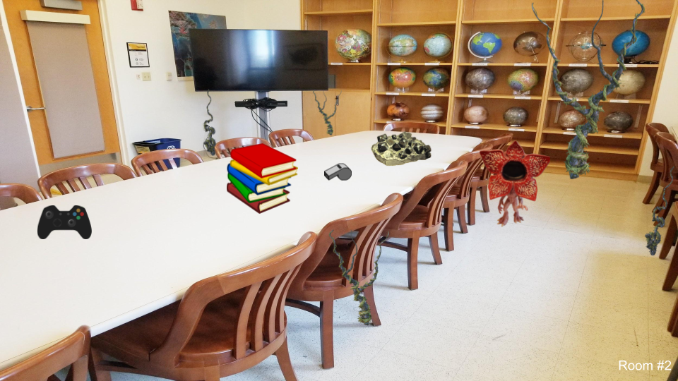 Room with a large table, television, and globes shelved in the back wall. Large table with a game console, whistle, books, and gems. On the floor is a demogorgon.